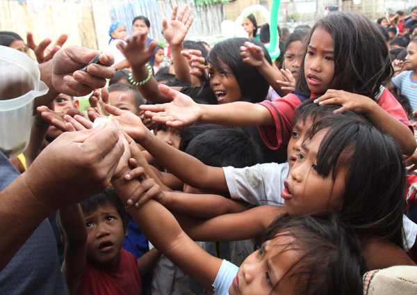 Children reach their hands to get a stub for a free meals IDIDIT Foundation #IDIDIT